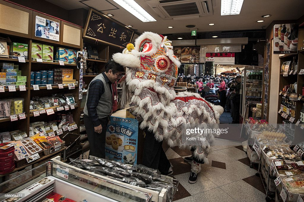 A lion dance is performed inside a shop in the Yokohama China Town on January 31, 2014 in Yokohama, Japan. It's the Lunar New Year and Year of the Horse, Chinese New Year is an important traditional Chinese holiday and it is celebrated worldwide within Chinese community.