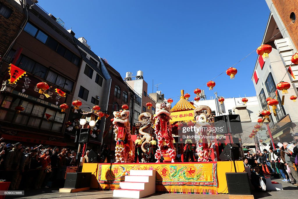 Lion dance performed a stage to celebrate the Chinese new year as people watch at the Nankinmachi square, China Town on February 8, 2016 in Kobe, Japan. In Nankinmachi, the district known as Kobe Chinatown, tourists enjoyed Chinese food, lion dance and the parade organized to celebrate the Lunar New Year.