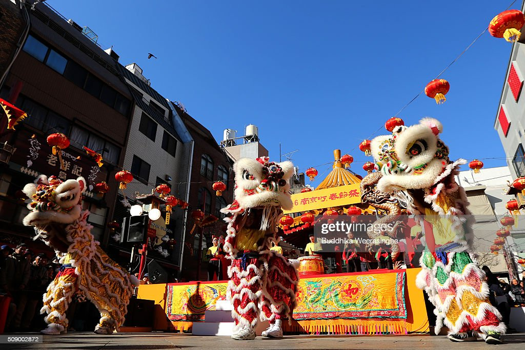 Lion dance performed to celebrate the Chinese new year as people watch at the Nankinmachi square, China Town on February 8, 2016 in Kobe, Japan. In Nankinmachi, the district known as Kobe Chinatown, tourists enjoyed Chinese food, lion dance and the parade organized to celebrate the Lunar New Year.