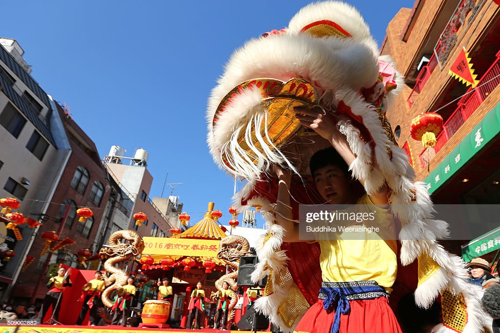 Lion dance performed to celebrate the Chinese new year at the Nankinmachi square, China Town on February 8, 2016 in Kobe, Japan. In Nankinmachi, the district known as Kobe Chinatown, tourists enjoyed Chinese food, lion dance and the parade organized to celebrate the Lunar New Year.