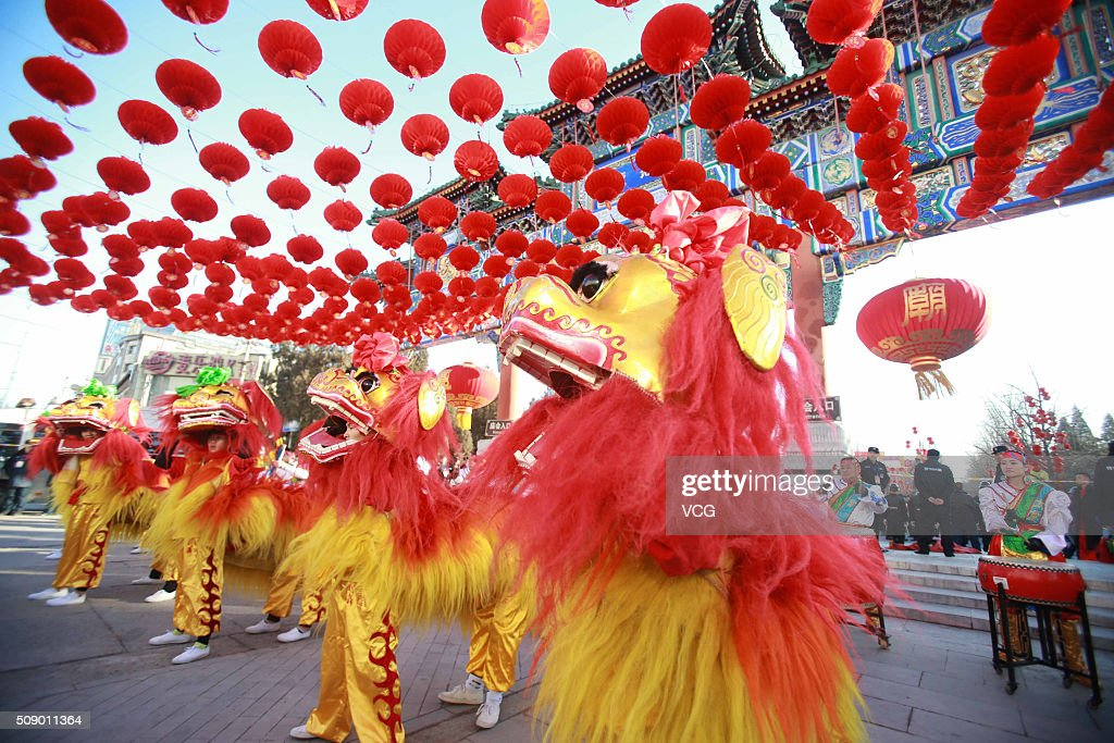 Lion dance show is performed as the Lunar New Year of the Monkey is celebrated at the temple fair at Ditan Park (the Temple of Earth) on February 8, 2016 in Beijing, China. The ceremony is once made by ancient China's emperors to worship the God of the Earth to pray for good harvests and fortune in the new year.