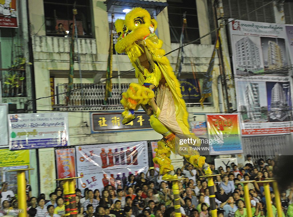 Lion dancers compete during the 'lion dance' competition in celebration of the Chinese new year in Yangon on February 14, 2013. AFP PHOTO/ Soe Than WIN