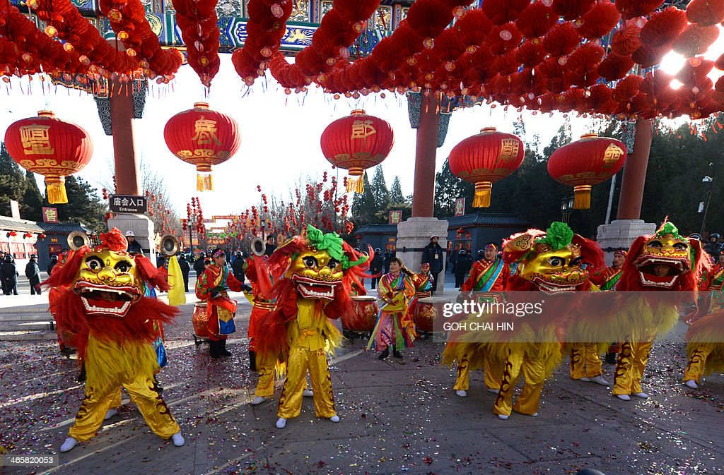 Lion dancers perform at the opening ceremony of the Ditan park temple fair in Beijing on January 30, 2014, on the eve of the Lunar New Year. Over a billion Chinese in China and millions more all over the world will be celebrating the Lunar New Year, known as the Spring Festival in China.