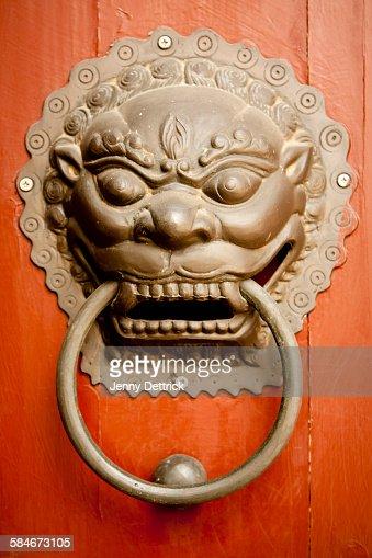 Lion Door Knocker on Red Door