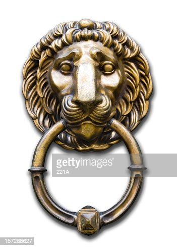 Lion head door knocker on white