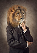 Lion in a suit. Man with a head of an lion. Concept graphic in vintage style with soft oil painting style