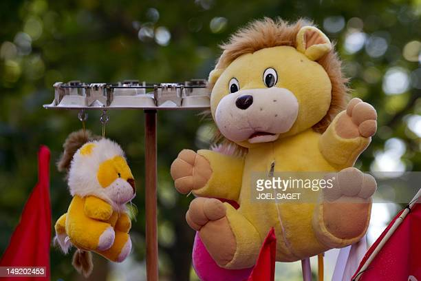 A Lion puppet referring to the Peugeot logo is pictured during a French car maker Peugeot PSA employees and unions demonstration against the planned...