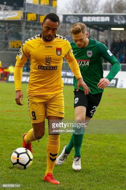 Lion Schweers of Muenster challenges Saliou Sane of SonnenhofGrossaspach during the 3 Liga match between SC Preussen Muenster and SG...
