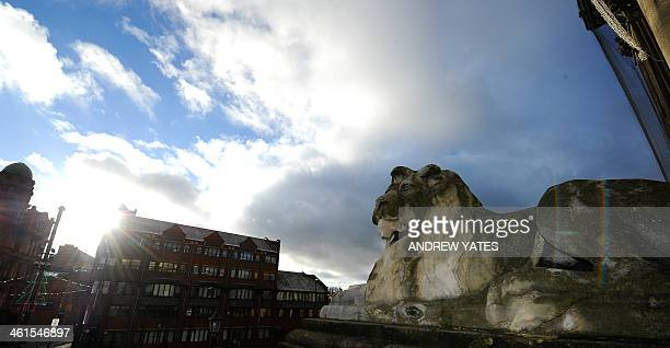 A Lion statue sits outside Leeds Town Hall in Leeds northwest England on January 9 2014 Leeds Town Hall was constructed in the mid 19th century after...