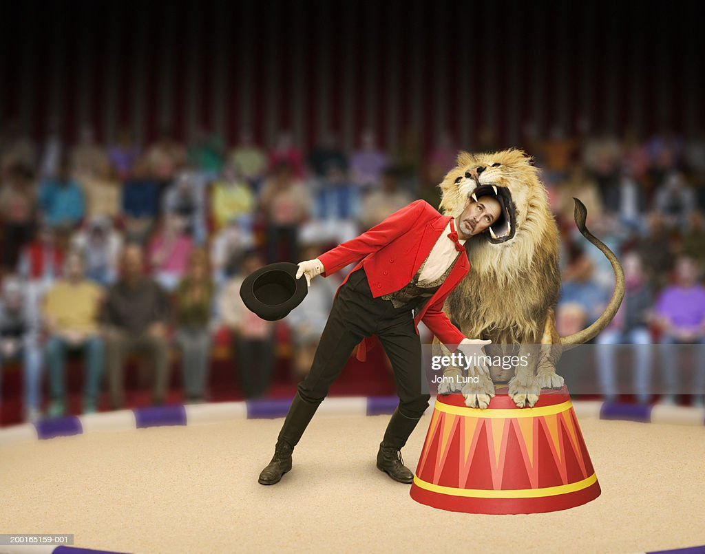 Lion trainer's head inside lion's mouth (Digital Composite) : Stock Photo