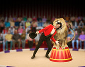 Lion trainer's head inside lion's mouth (Digital Composite)