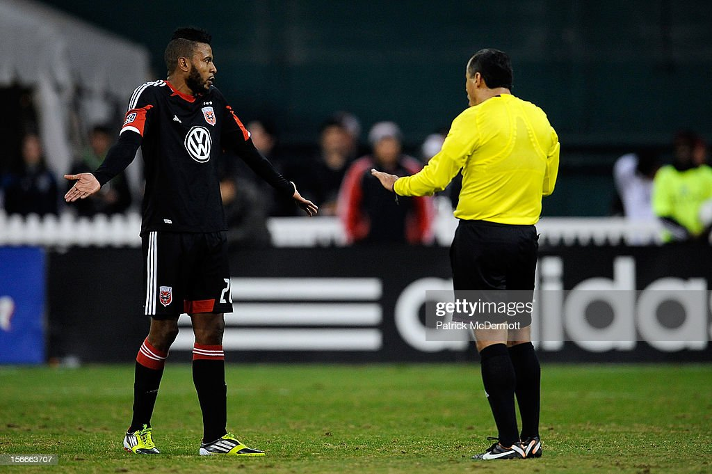 Lionard Pajoy #26 of D.C. United argues with referee Baldomero Toledo during leg 2 of the Eastern Conference Championship against the Houston Dynamo at RFK Stadium on November 18, 2012 in Washington, DC.