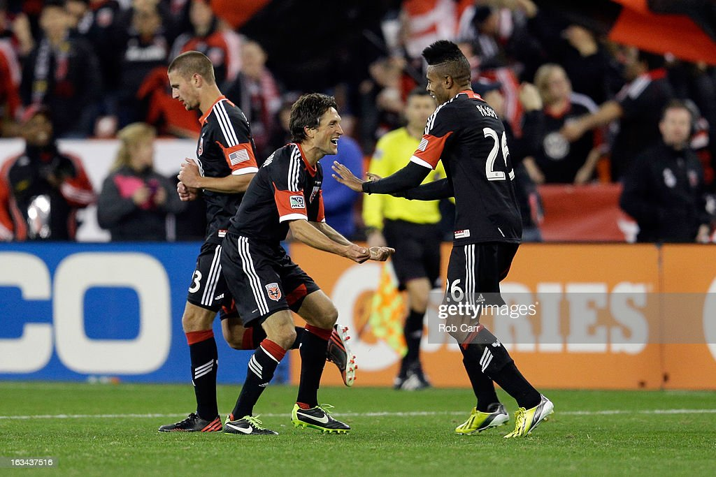 Lionard Pajoy #26 of D.C. United celebrates his second half goal with teammate John Thorrington #8 (L) against the Real Salt Lake at RFK Stadium on March 9, 2013 in Washington, DC.