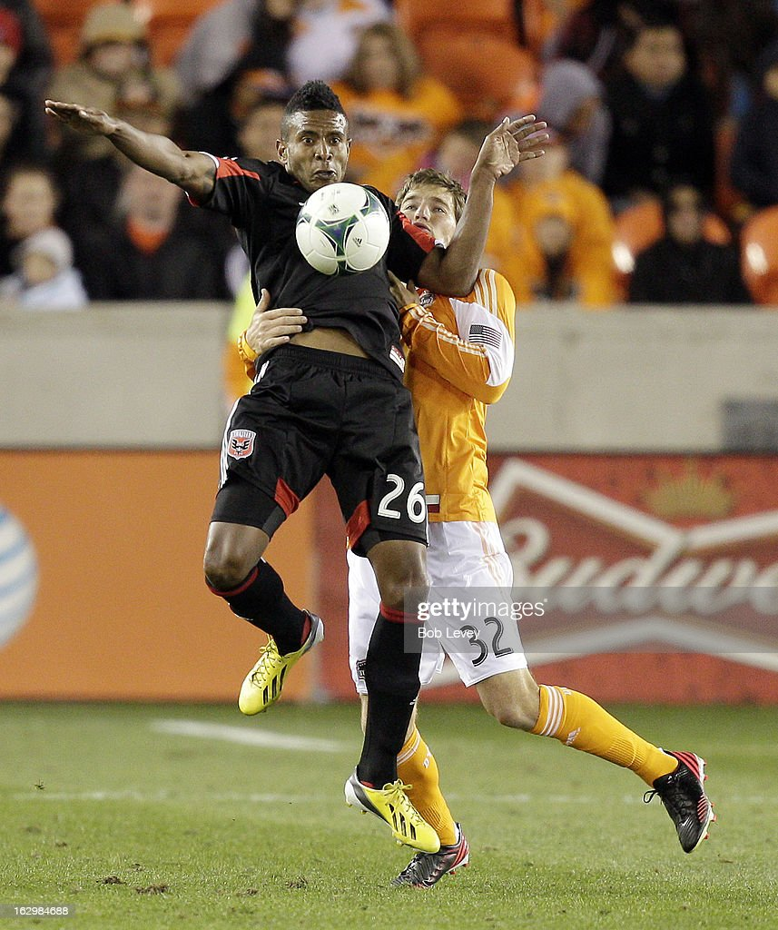 Lionard Pajoy #26 of D.C. United chests the ball down as <a gi-track='captionPersonalityLinkClicked' href=/galleries/search?phrase=Bobby+Boswell+-+Soccer+Player&family=editorial&specificpeople=587535 ng-click='$event.stopPropagation()'>Bobby Boswell</a> #32 of the Houston Dynamo applies pressure during second half action at BBVA Compass Stadium on March 2, 2013 in Houston, Texas. Houston won 2-0.