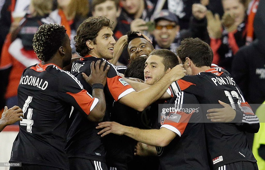 Lionard Pajoy #26 of D.C. United is mobbed by teammates after scoring a second half goal against the Real Salt Lake at RFK Stadium on March 9, 2013 in Washington, DC.