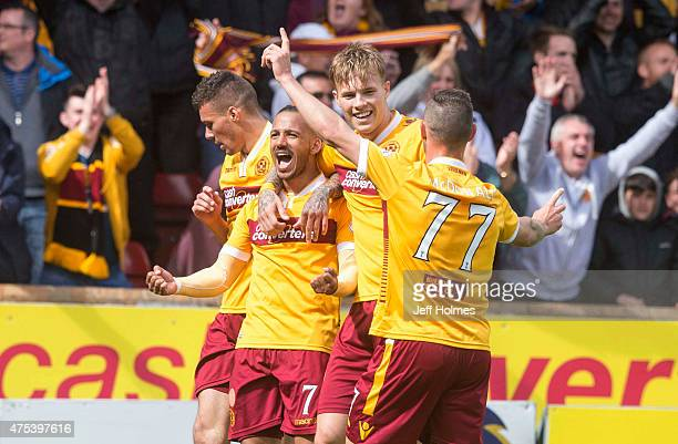 Lionel Ainsworth of Motherwell celebrates his goal making it 20 with team mates during the Scottish Premiership playoff final 2nd leg between...