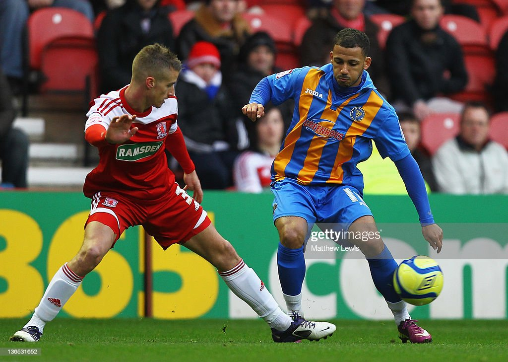 Lionel Ainsworth of Shrewsbyury and Joe Bennett of Middlesbrough challenge for the ball during the FA Cup Third Round match between Middlesbrough and Shrewsbury Town at Riverside Stadium on January 7, 2012 in Middlesbrough, England.