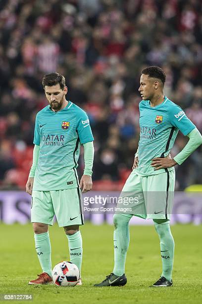 Lionel Andres Messi and teammate Neymar da Silva Santos Junior of FC Barcelona reacts during their Copa del Rey Round of 16 first leg match between...