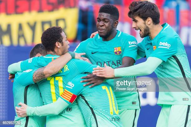 Lionel Andres Messi of FC Barcelona celebrates with teammates Neymar da Silva Santos Junior Samuel Umtiti and Sergi Roberto Carnicer during their La...
