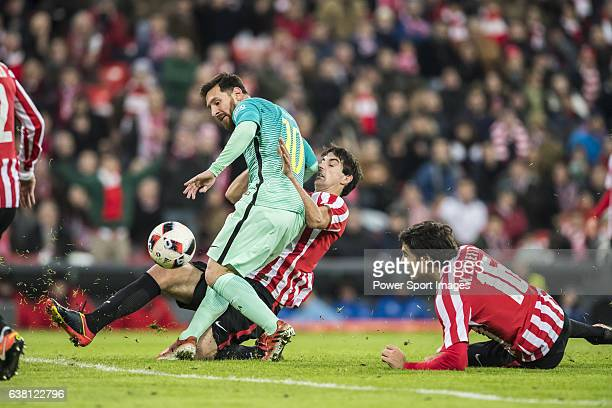 Lionel Andres Messi of FC Barcelona competes for the ball with Mikel San Jose Dominguez of Athletic Club during their Copa del Rey Round of 16 first...