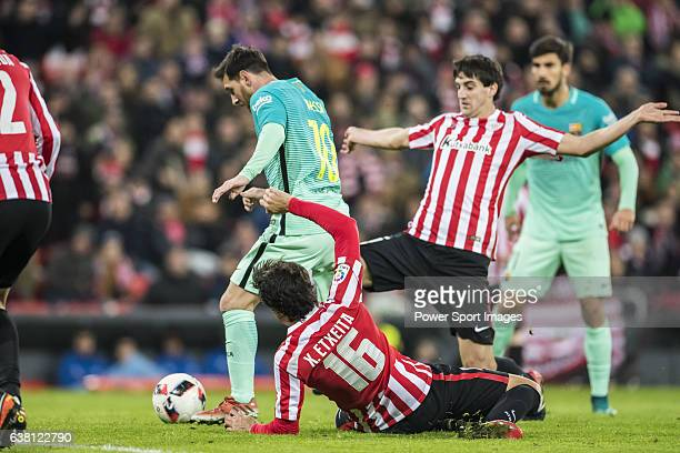 Lionel Andres Messi of FC Barcelona fights for the ball with Xabier Etxeita Gorritxategi of Athletic Club during their Copa del Rey Round of 16 first...