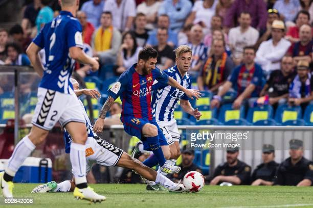 Lionel Andres Messi of FC Barcelona in action against Marcos Llorente of Deportivo Alaves during the Copa Del Rey Final between FC Barcelona and...