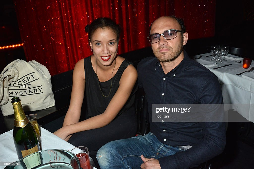 Lionel Bensemoun (R) and Ambre attends the 'Joyeux Paradis' Party by Emmanuel d'Orazio & Marc Zaffuto at Le Paradis Latin on December 20, 2012 in Paris, France.