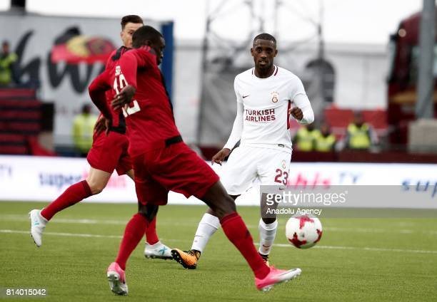 Lionel Carole of Galatasaray in action against Ken Sema of Ostersund during the UEFA Europa League 2nd Qualifying Round soccer match between...
