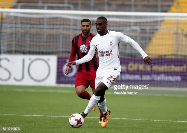 Lionel Carole of Galatasaray in action against Saman Ghoddos of Ostersund during the UEFA Europa League 2nd Qualifying Round soccer match between...