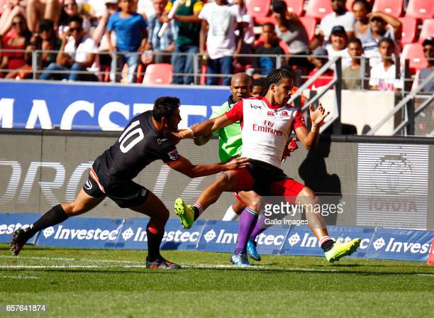 Lionel Cronje of the Southern Kings tackles Madosh Tambwe of the Lions during the Super Rugby match between Southern Kings and Emirates Lions at...