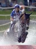 Lionel Guyon of France riding Nemetis de Lalou negotiates the water jump in the Eventing Cross Country Equestrian event on Day 3 of the London 2012...