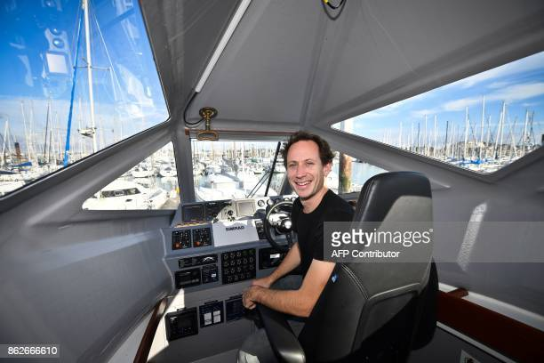 Lionel Huetz CEO of Advanced Aerodynamic Vessels company poses in his new transportation vessel in La Rochelle southwestern France on October 12 2017...