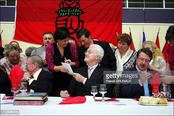 Lionel Jospin signs autographs on the menus of diners at the celebration of the Rose socialist section Wattrelos in Wattelos France on March 25th 2007