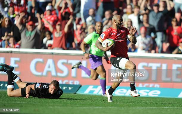 Lionel Mapoe of Lions scoring his try with Curwin Bosch of the Sharks on the ground during the Super Rugby Quarter final between Emirates Lions and...