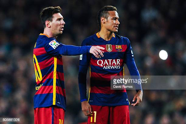 Lionel Mess and Neymar of FC Barcelona stand next to the ball before taking a free kick during the La Liga match between FC Barcelona and Athletic...
