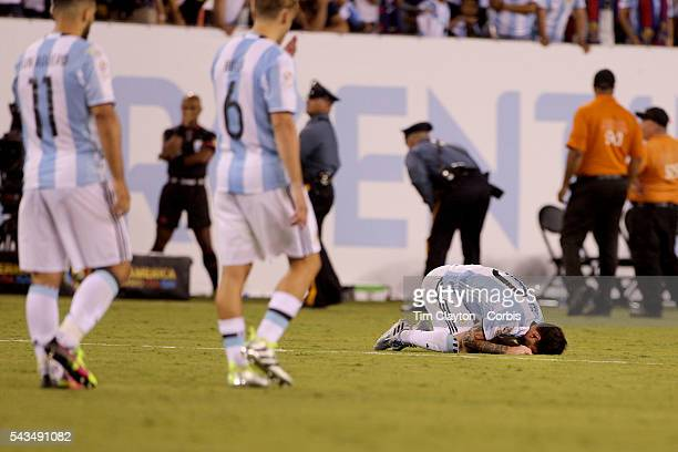 Lionel Messi #10 of Argentina distraught on the half way line after missing a penalty in the penalty shoot out during the Argentina Vs Chile Final...