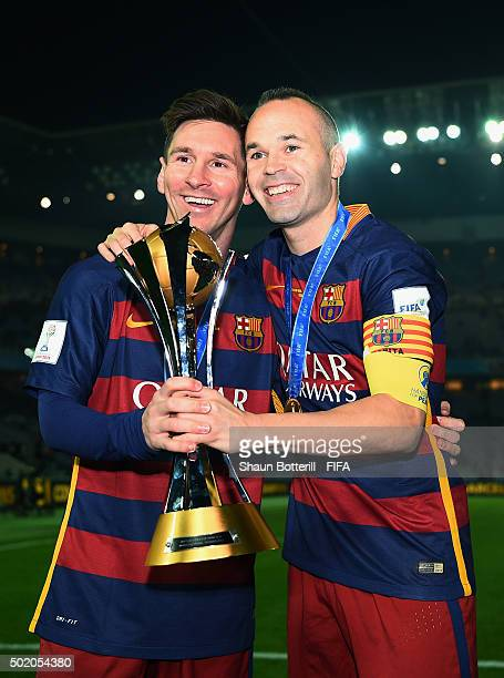 Lionel Messi and Andres Iniesta of Barcelona celebrate with the trophy following their team's 30 victory during the FIFA Club World Cup Final between...