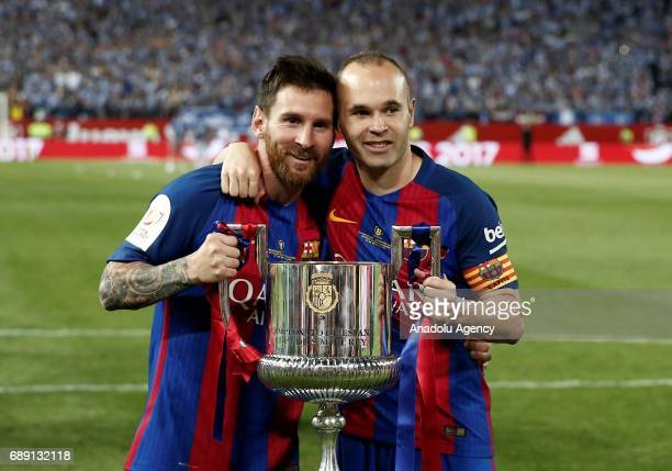 Lionel Messi and Andres Iniesta of Barcelona celebrate with the trophy after the Copa Del Rey Final between FC Barcelona and Deportivo Alaves at...