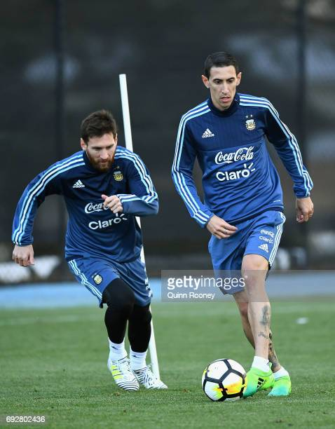 Lionel Messi and Angel Di Maria of Argentin run with the ball during an Argentina Training Session at City Football Academy on June 6 2017 in...