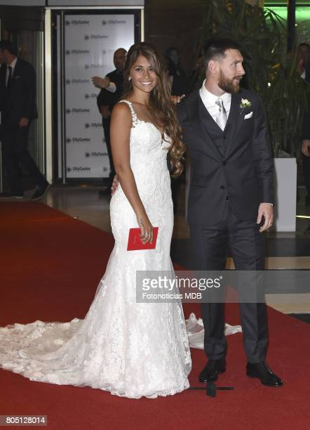 Lionel Messi and Antonela Roccuzzo greet the press after their civil wedding ceremony at the City Center Rosario Hotel Casino on June 30 2017 in...