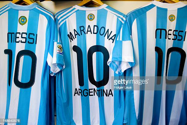 Lionel Messi and Diego Maradona Argentine national football team jerseys for sale.