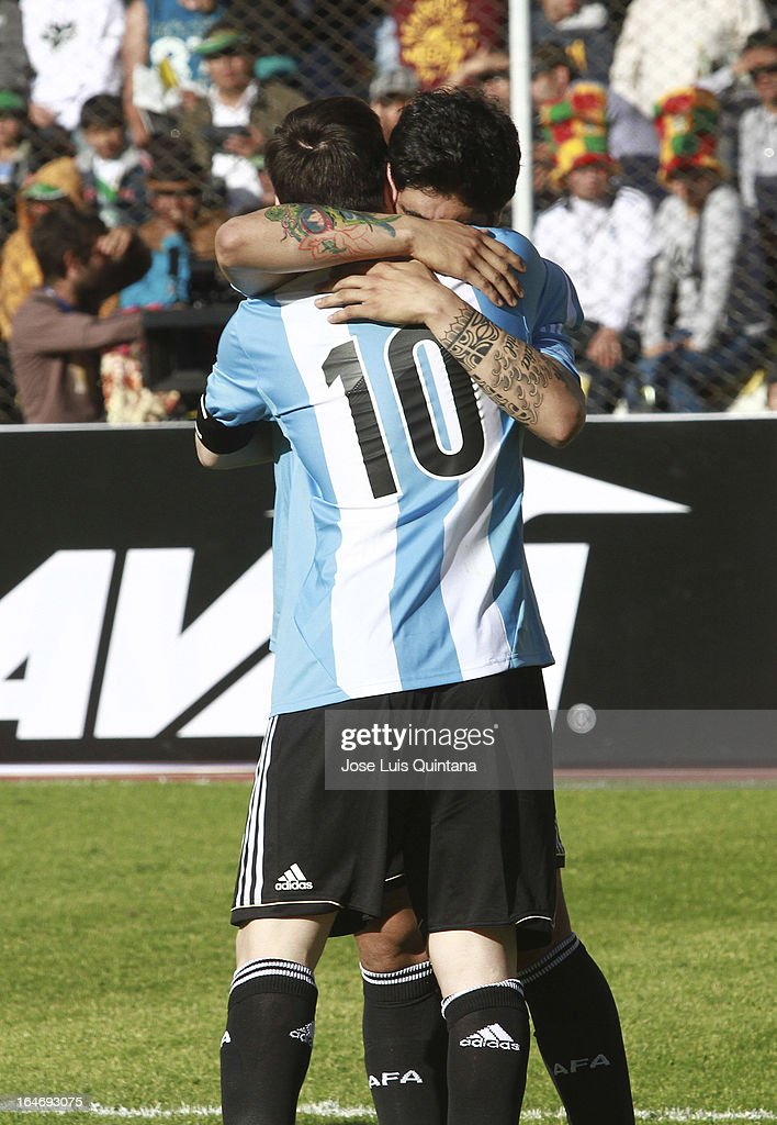 <a gi-track='captionPersonalityLinkClicked' href=/galleries/search?phrase=Lionel+Messi&family=editorial&specificpeople=453305 ng-click='$event.stopPropagation()'>Lionel Messi</a> (#10) and Ever Banega of Argentina celebrate the goal of their team during a match between Bolivia and Argentina as part of the 12th round of the South American Qualifiers for the FIFA World Cup Brazil 2014 at the Hernando Siles Stadium on March 26, 2013 in La Paz, Bolivia.