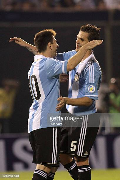 Lionel Messi and Fernando Gago of Argentina celebrates a scored goal against Paraguay during a match between Paraguay and Argentina as part of the...