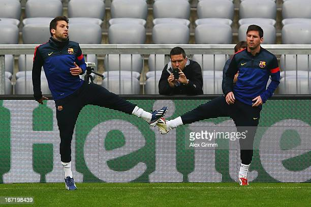 Lionel Messi and Jordi Alba exercise during a FC Barcelona press conference ahead of their UEFA Champions League Semi Final first leg match against...