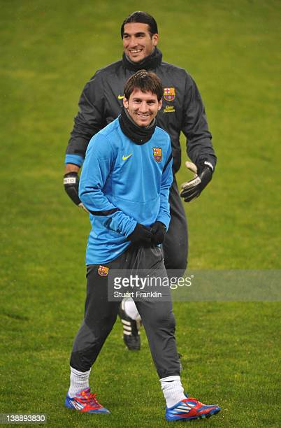 Lionel Messi and José Manuel Pinto of FC Barcelona look happy during training at the BayArena on February 13 2012 in Leverkusen Germany