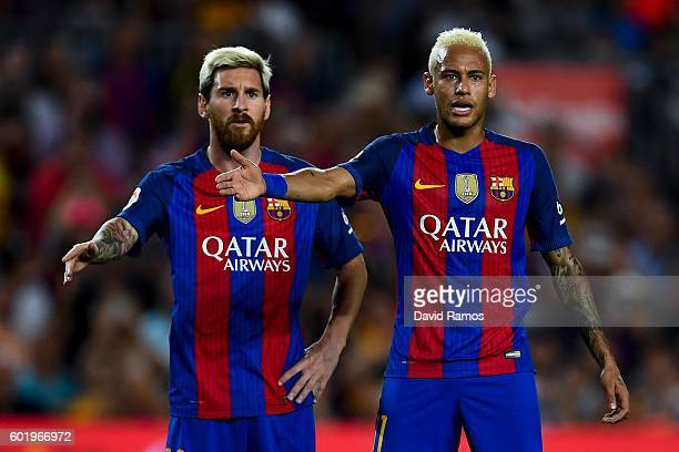 Lionel Messi and Neymar Jr of FC Barcelona react during the La Liga match between FC Barcelona and Deportivo Alaves at Camp Nou stadium on September...