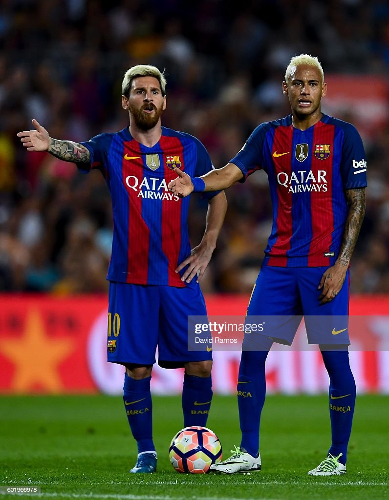 Lionel Messi (L) and Neymar Jr. of FC Barcelona react during the La Liga match between FC Barcelona and Deportivo Alaves at Camp Nou stadium on September 10, 2016 in Barcelona, Spain.
