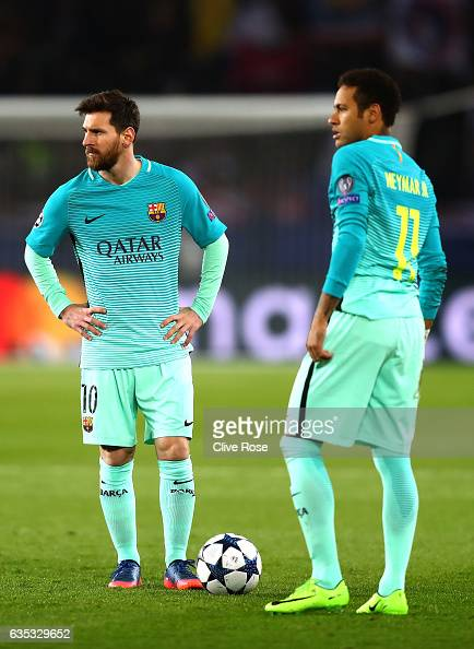 Lionel Messi and Neymar of Barcelona look on during the UEFA Champions League Round of 16 first leg match between Paris SaintGermain and FC Barcelona...