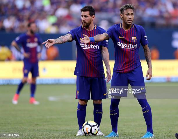 Lionel Messi and Neymar of Barcelona react to the way Juventus lined up for a kick in the first half during the International Champions Cup 2017 on...