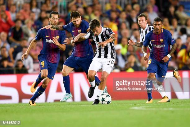 Lionel Messi and Paulo Dybala during the UEFA Champions League group D match between FC Barcelona and Juventus at Camp Nou on September 12 2017 in...